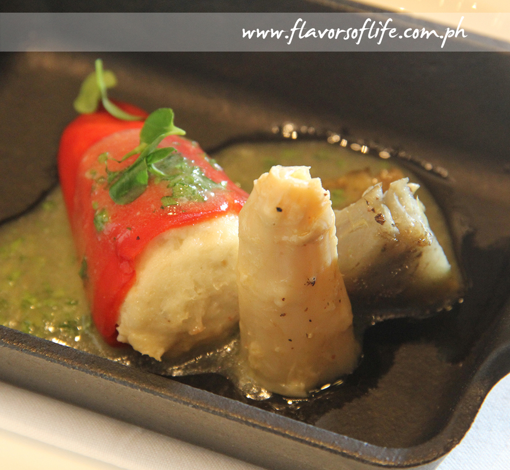 Piquillo Peppers Stuffed with Cod Fish Brandada, Pil-pil Sauce and Artichokes on a White Asparagus Bed