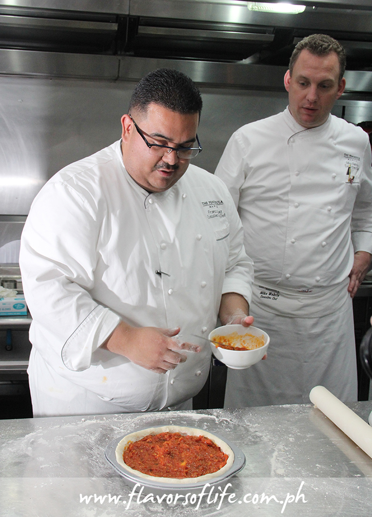 Executive sous chef Franco Diaz (left) and executive chef Mike Wehrle of The Peninsula Manila showing how to make a 'Chicago style Deep Dish Pizza'