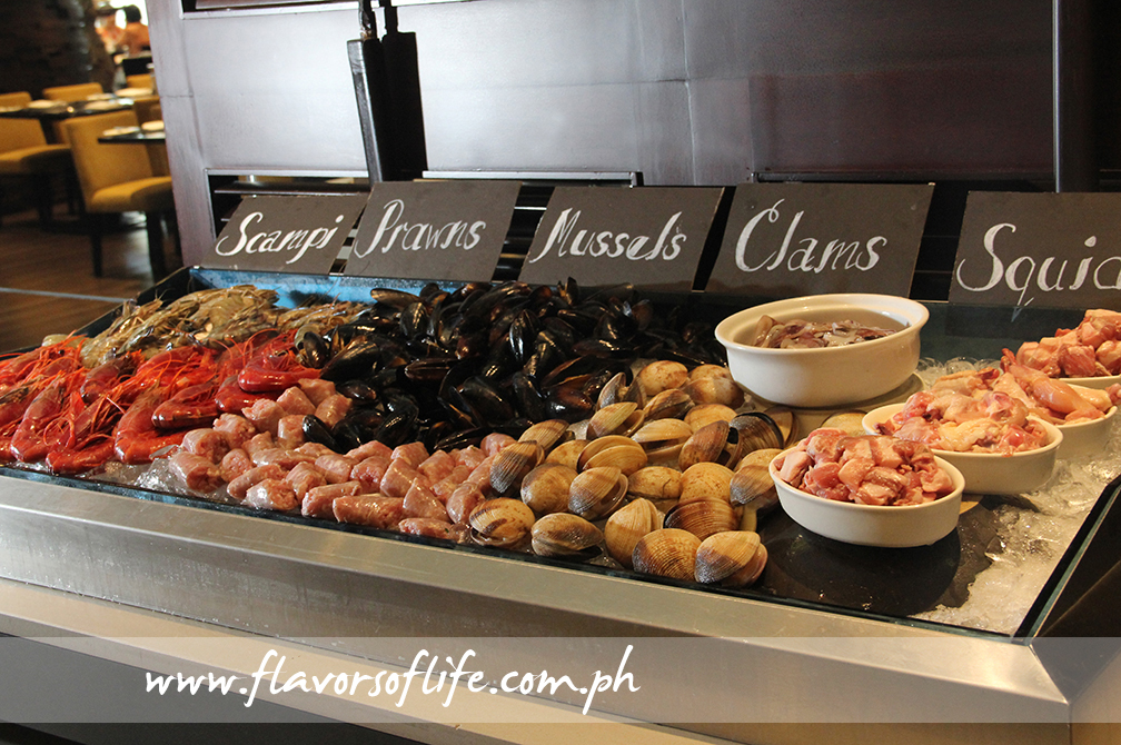 Fresh seafood, meat and sausages used by Chef Lluis Cantons Pessarodona for his paella