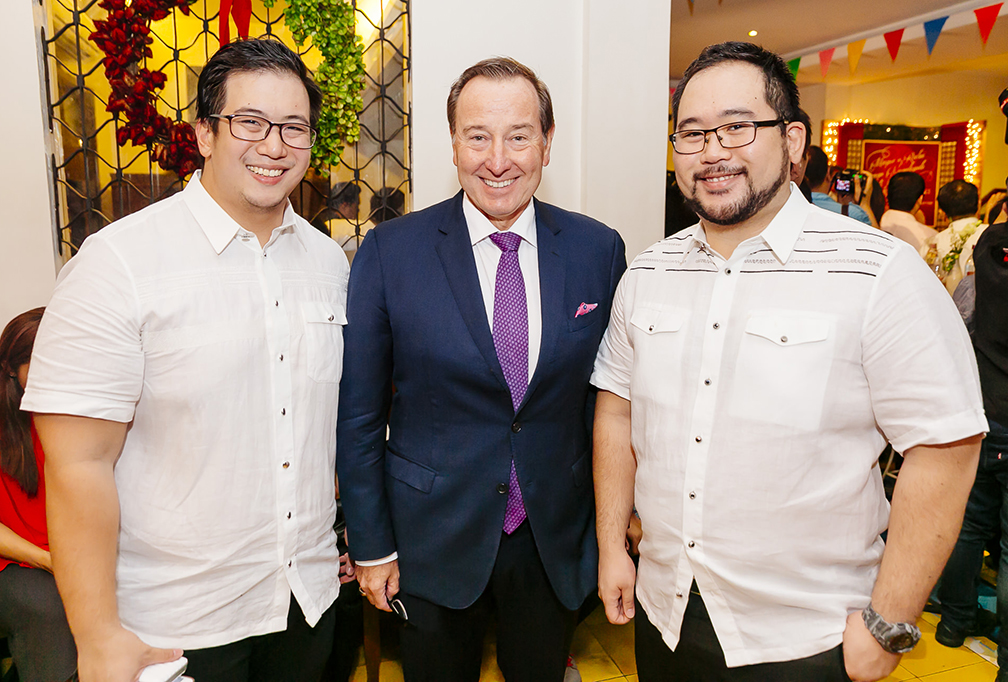 Aaron and Clifford Aw flank Marco Polo Ortigas GM Frank Reichenbach