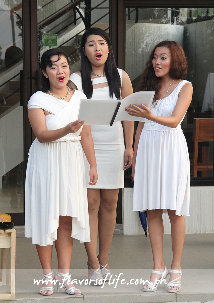 Three young ladies serenading the guests with festive Christmas carols