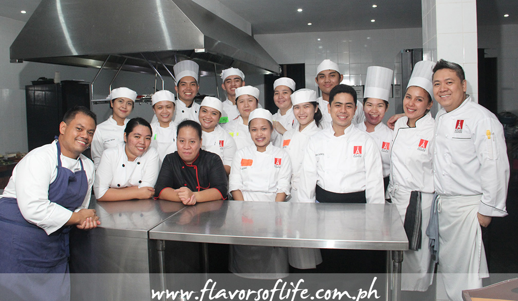 Chef Robbie Ripalda (extreme left) and Chef Lawrence Zafra (extreme right) and the students of Atlas Culinary School take charge of the kitchen at The Domaine