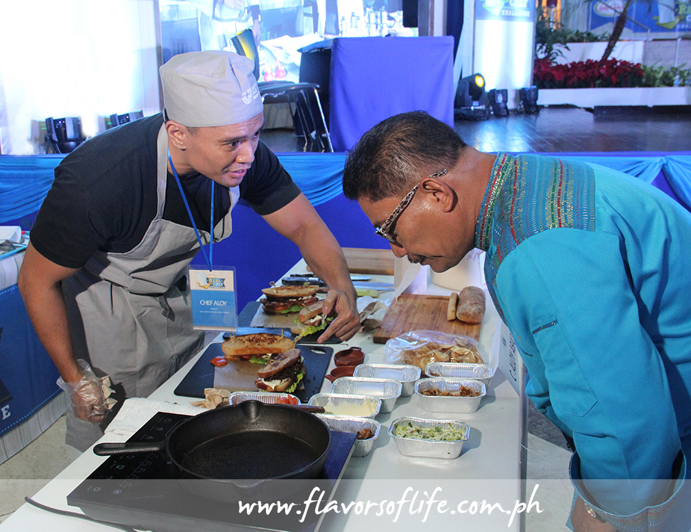 Aloysius Mark Abad at work on his sandwich, with Chef Boy Logro looking on
