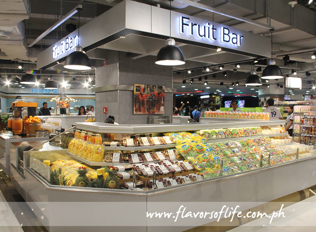 The fruit bar offers a variety of ready-to-eat sliced and juiced fresh fruits, salad packs and more