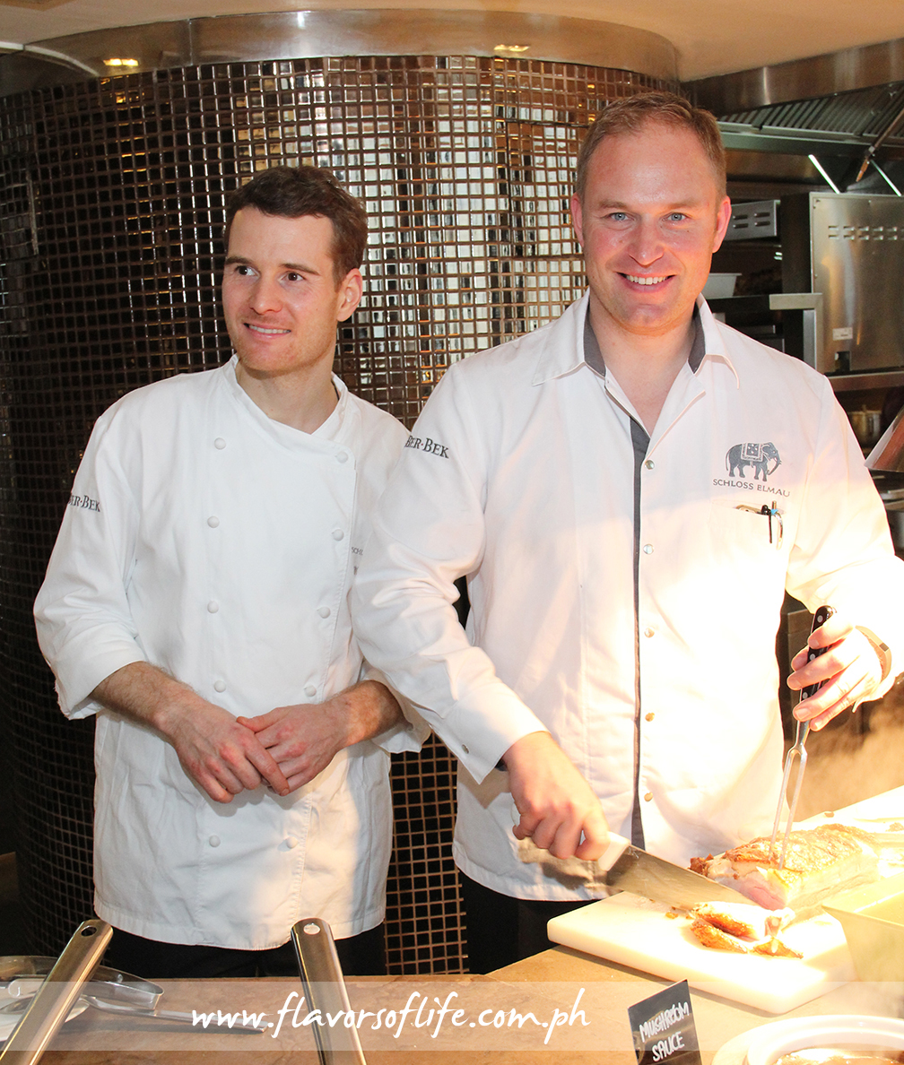 German guest chefs Mario Paecke and Christian Scheler serving Crispy Pork Belly at the carving station