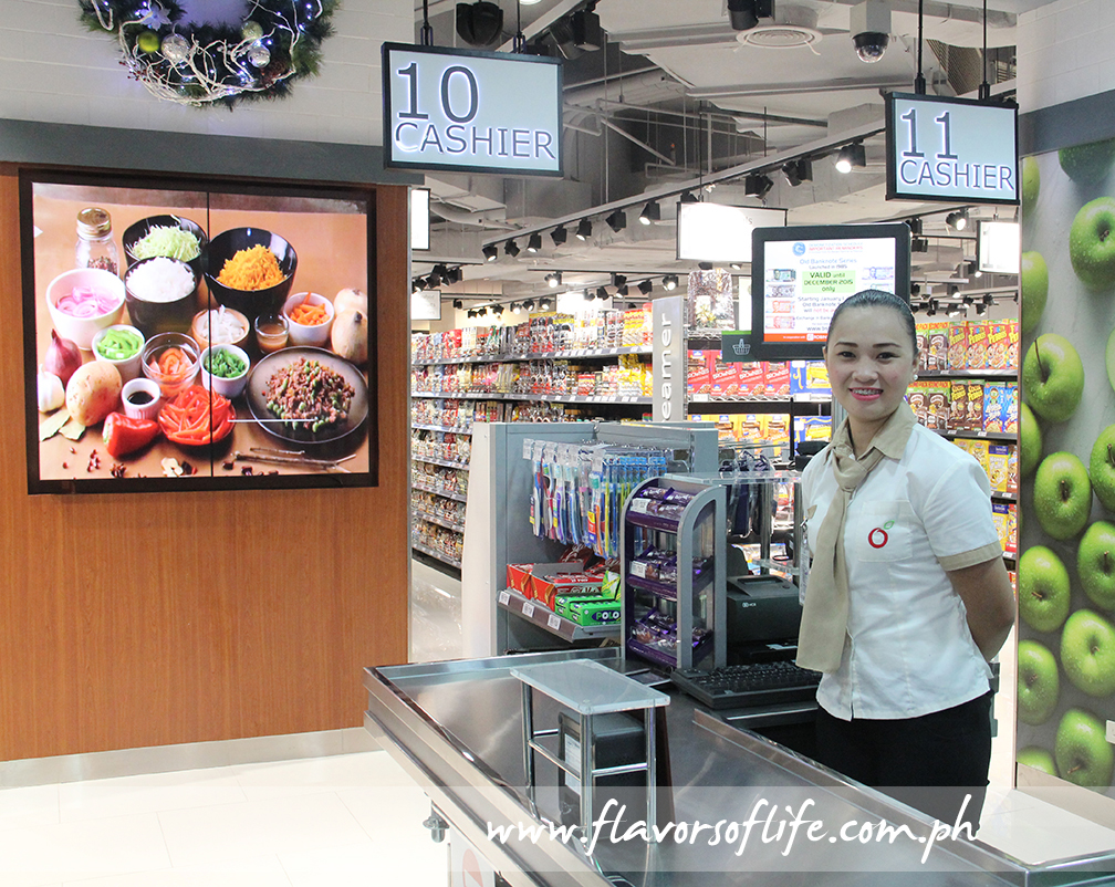 Cashier equipped with fast, high-tech machines and the video screens spread all around the store