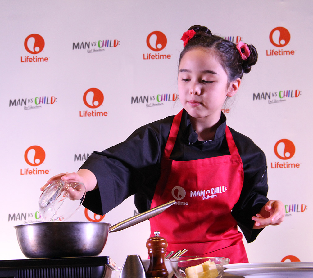 Eight-year-old chef Estie Kung working on her salmon dish