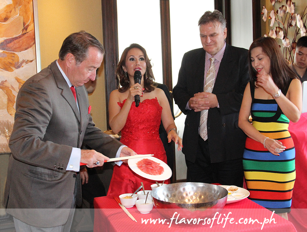 Marco Polo Ortigas GM Frank Reichenbach (extreme left), feng shui expert Marites Allen (second to the left) put the Yu Sheng Salad together for tossing