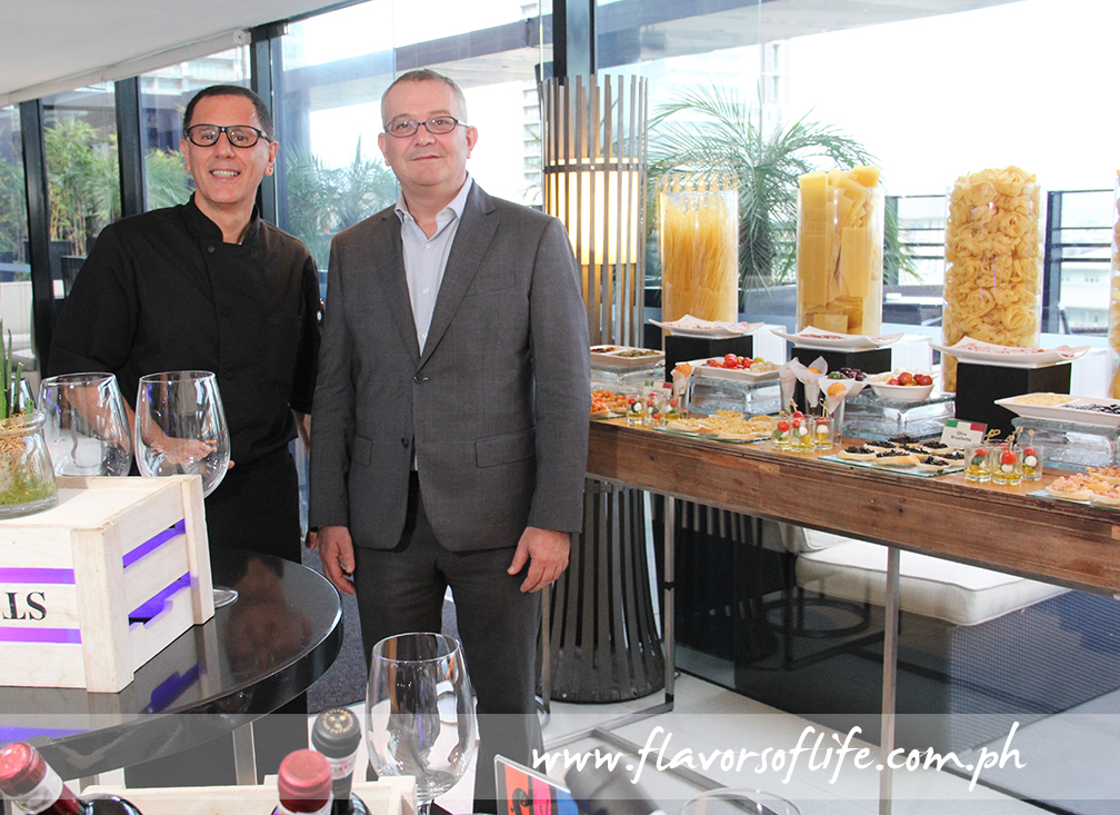 Italian guest chef Salvatore del Vincentis, here seen with Seda Hotel BGC's general manager Andrea Mastellone, prepares a good apericena spread of authentic Italian regional dishes
