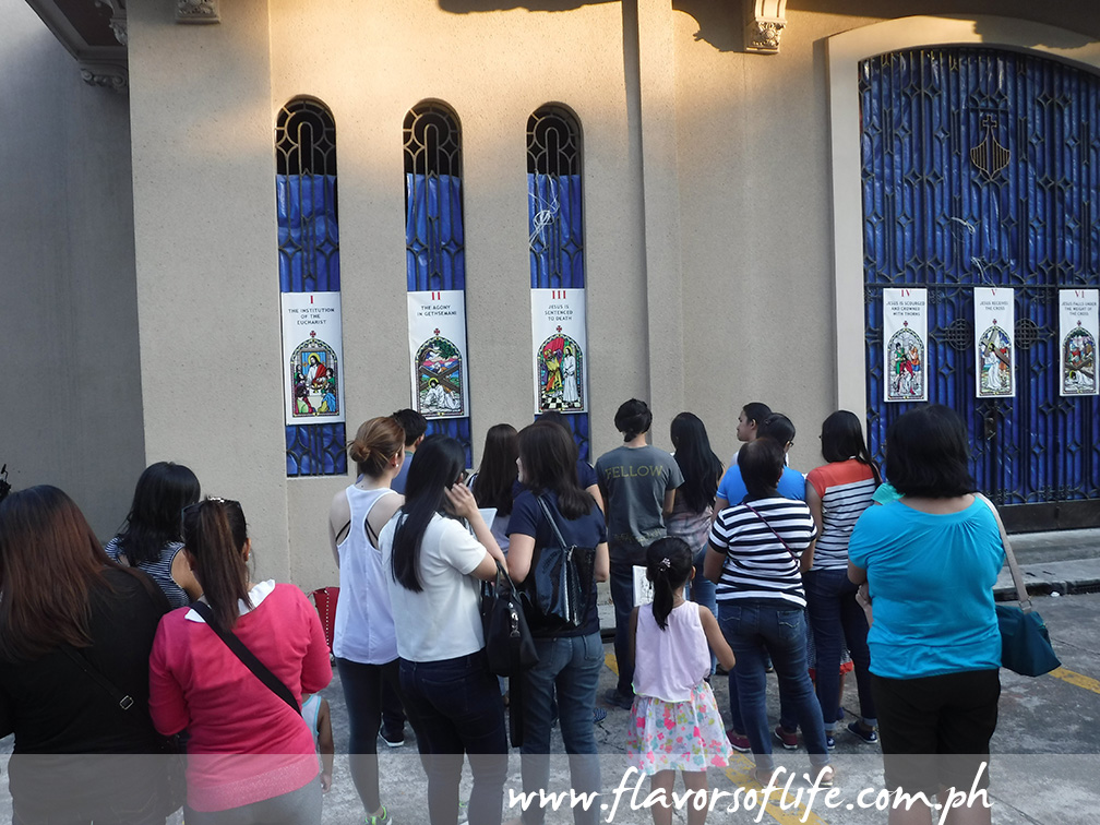 Crowds of devotees gather outside the church for the Stations of the Cross