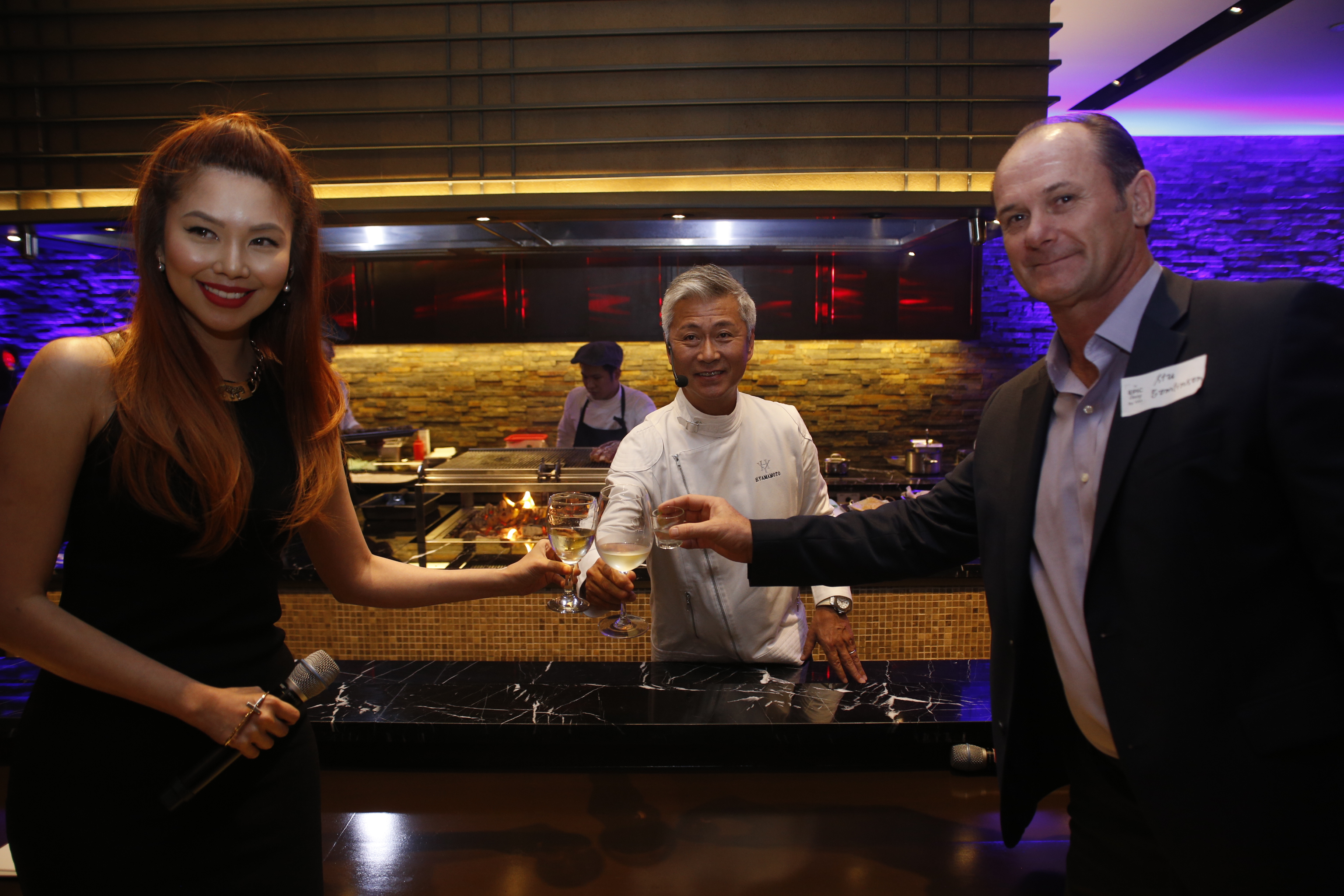 At the ceremonial toast during the formal launch of 'Epic Dining by Visa,' from left: event host Bianca Valerio, Chef Hide Yamamoto, and Visa country manager for the Philippines and Guam Stuart Tomlinson