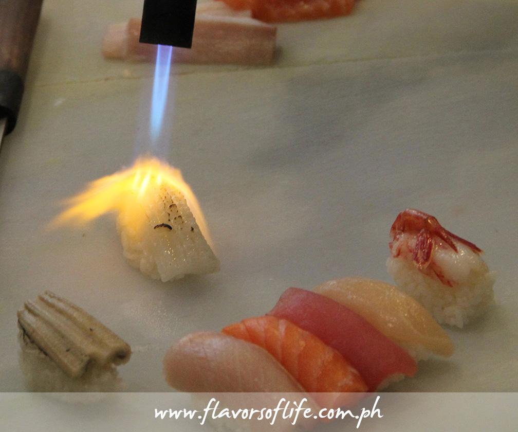 Torching the Matsusaka Beef Sushi...