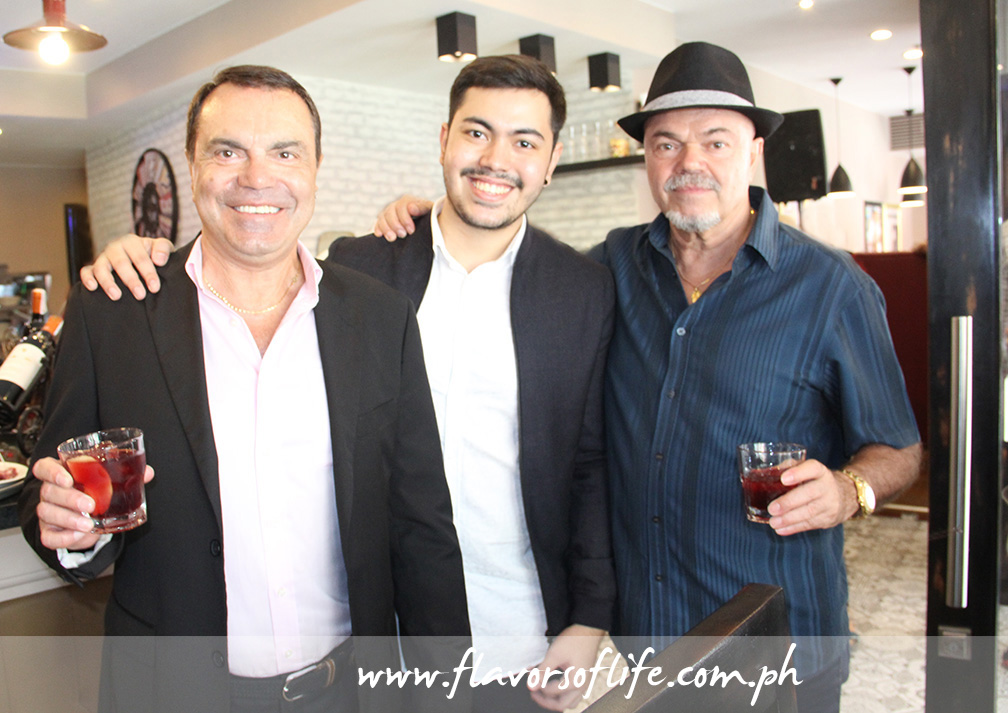 Brothers Antonio Carmine 'Toni' Iapino and Sergio Candido Iapino flanking Toni's son Giulius Caezar Iapino