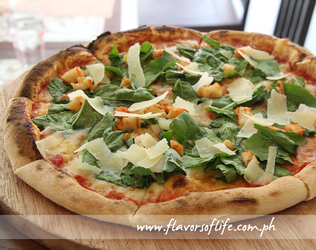 Pizza Gamberetti con Rucola is tomato sauce, mozzarella cheese, shrimps and arugula on hand-tossed pizza dough