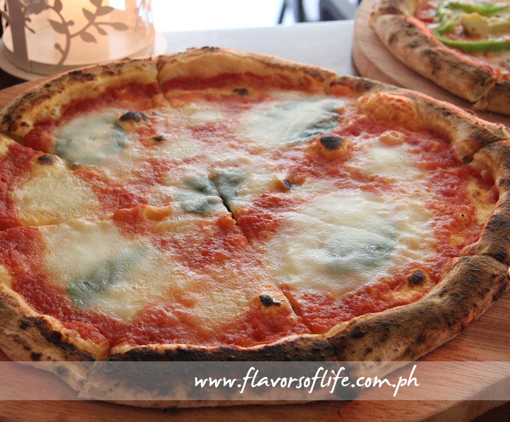 Pizza Margherita con Bufala is simple but flavorful tomato sauce, buffalo mozzarella cheese and basil leaves