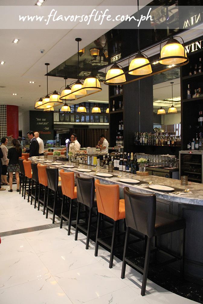 The bar area of Todd English Food Hall
