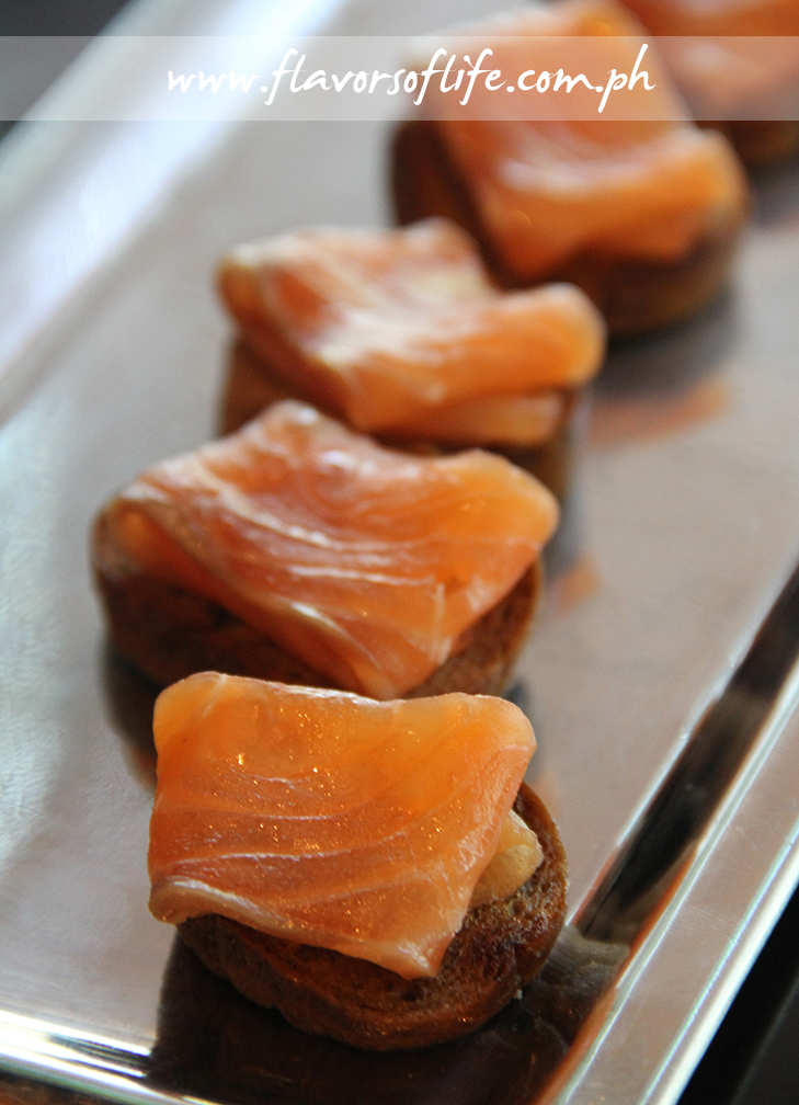 Salmon Gravlax with Dill, Citrus and Coriander Seeds on canapes