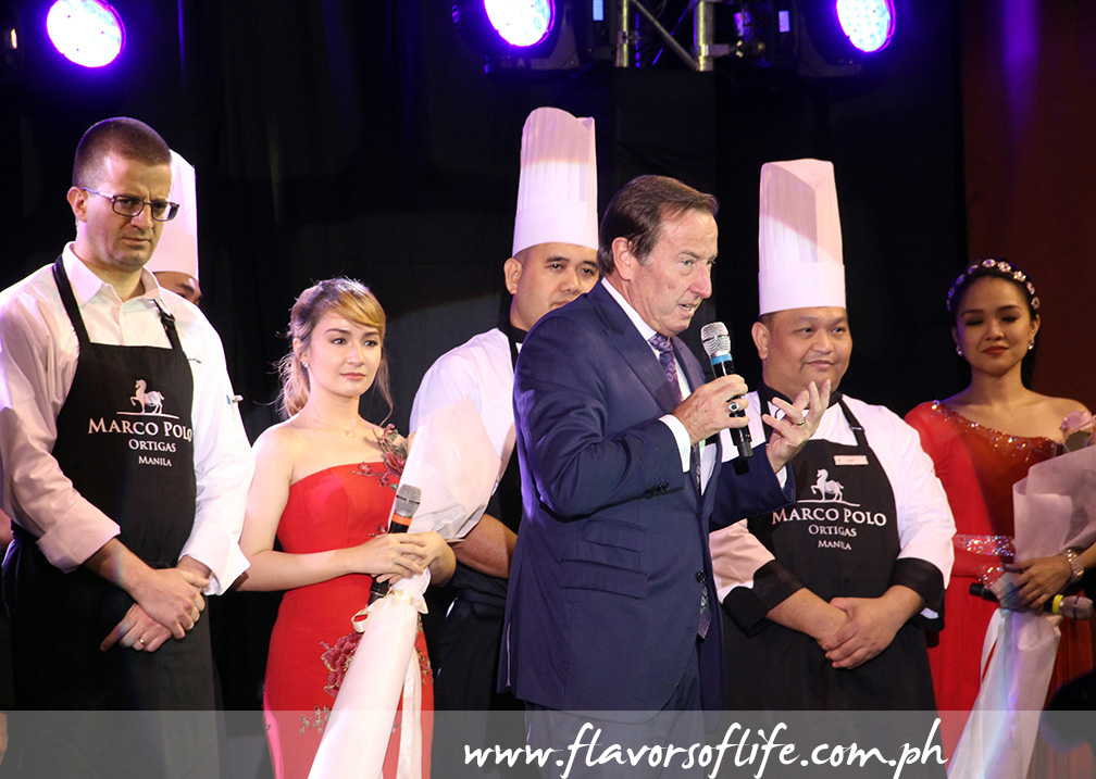 Marco Polo Ortigas Manila's GM Frank Reichenbach thanks everyone, with Executive Chef Lluis Pesarrodona and staff on stage with him