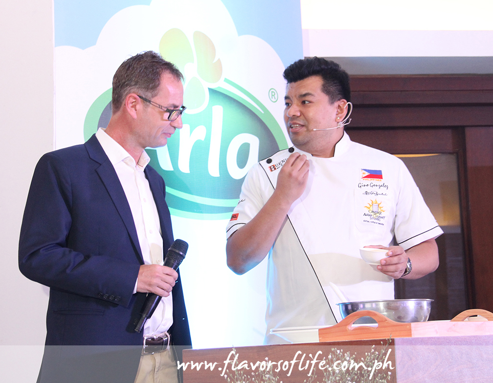 Chef Gino Gonzalez, joined by Arla Foods' Jens Christian Krogh Nielsen, as he conducted a cooking demonstration on how to prepare 'Arla Cheesy Spread Pandenini'