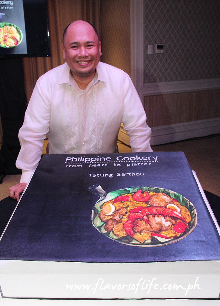 At the formal launch held at Aruga Hotel, Chef Tatung Sarthou stands behind the cake version of his book whipped up by Chef Edward David Mateo