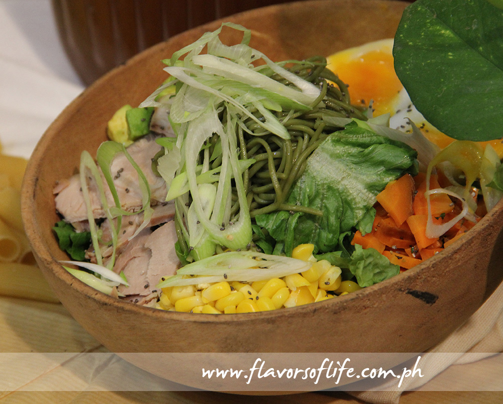 Green Pastures' Chasu Misoba Salad consists of mixed greens, cold buckwheat noodles, corn, 8-hour roast pork, avocado, roasted carrots, leeks and scallions