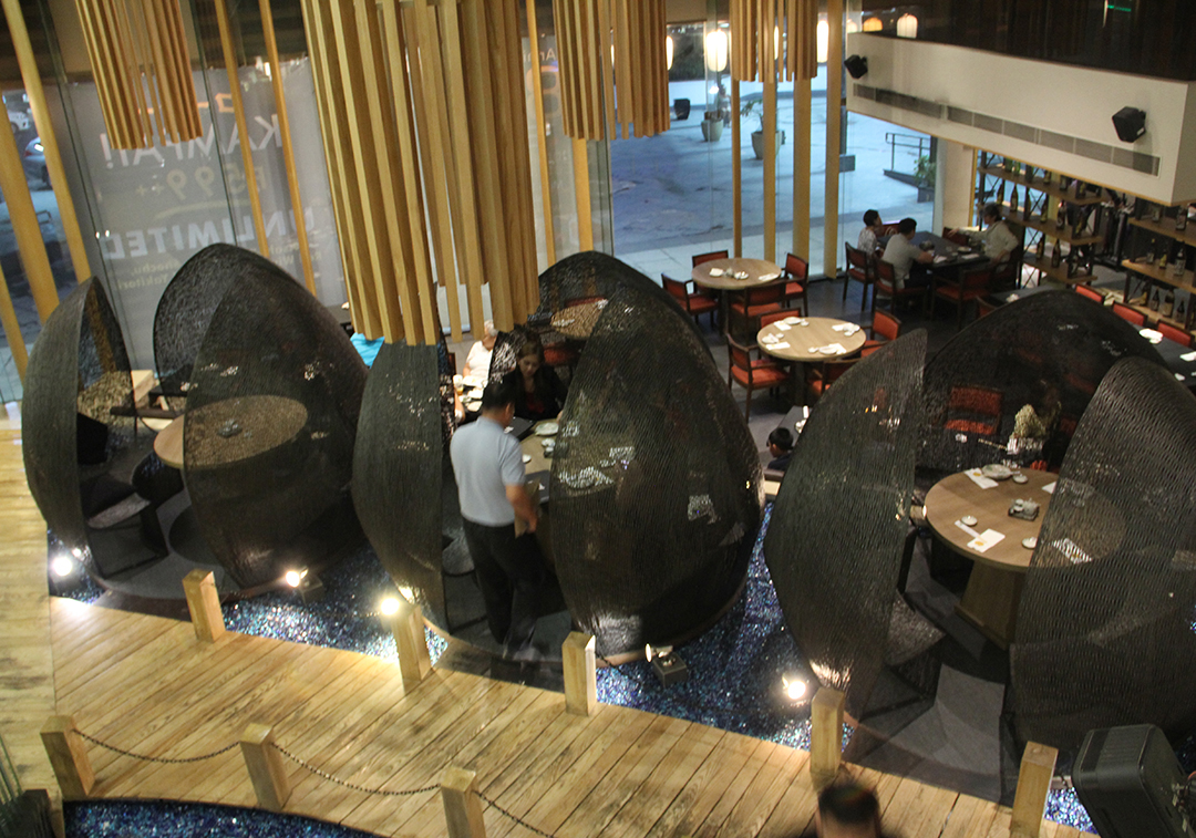 The three Lotus Pod dining tabes designed by Amy Pamintuan are top favorites of diners at Wafu