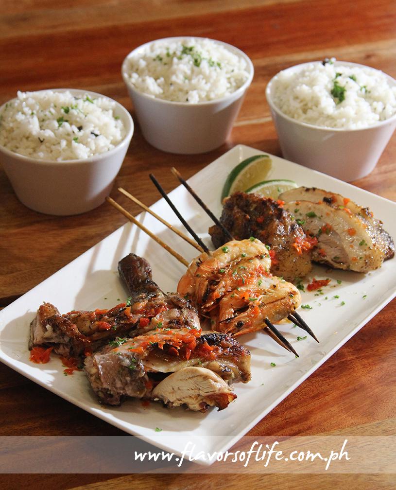 Gostoso's 'Have It All Platter' combines Piri Piri Chicken, Espeto de Gambas, and Porco Gostoso