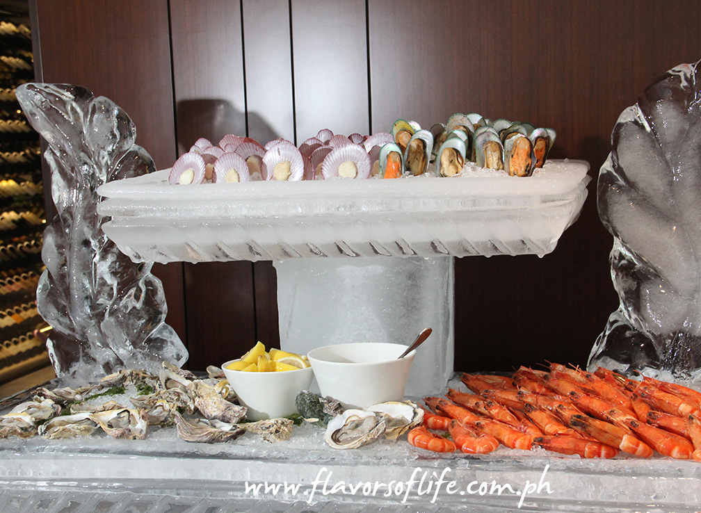 Fresh seafood on ice include oysters, mussels, prawns and