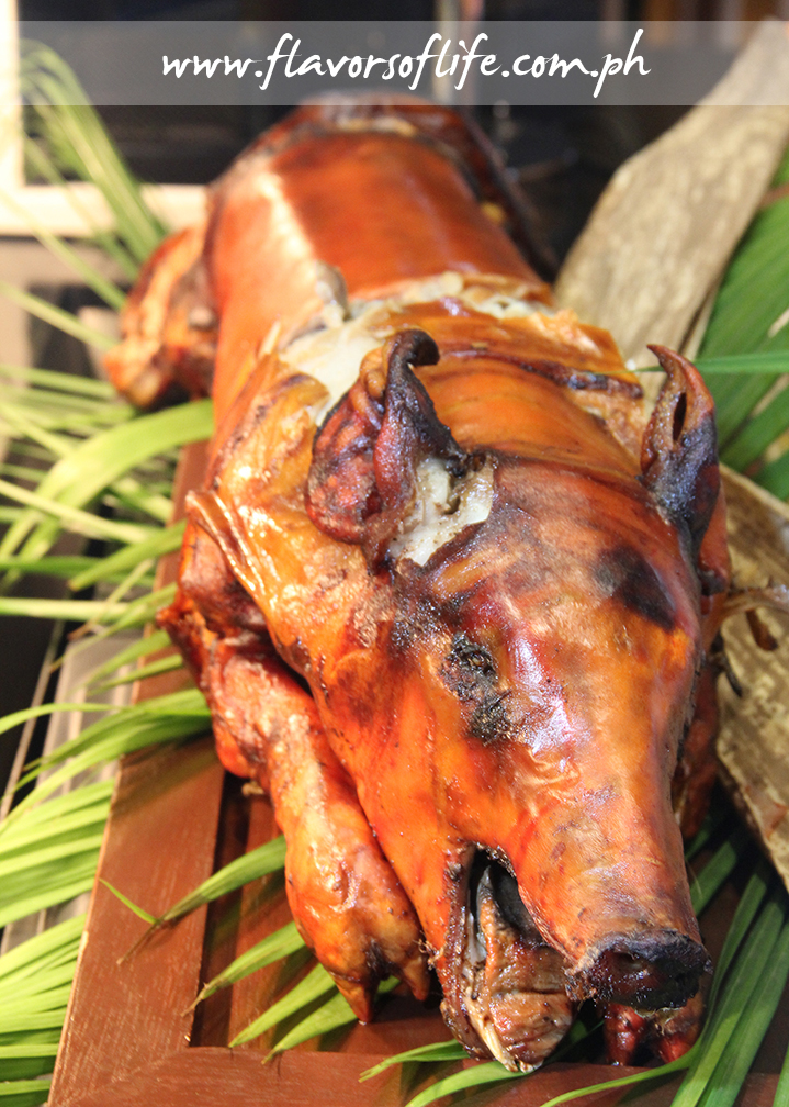 Lechon at the carving station is served with three kinds of sauces