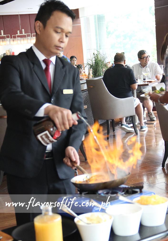 Showmanship at its best: Preparing Mango Crepes Flambe at tableside