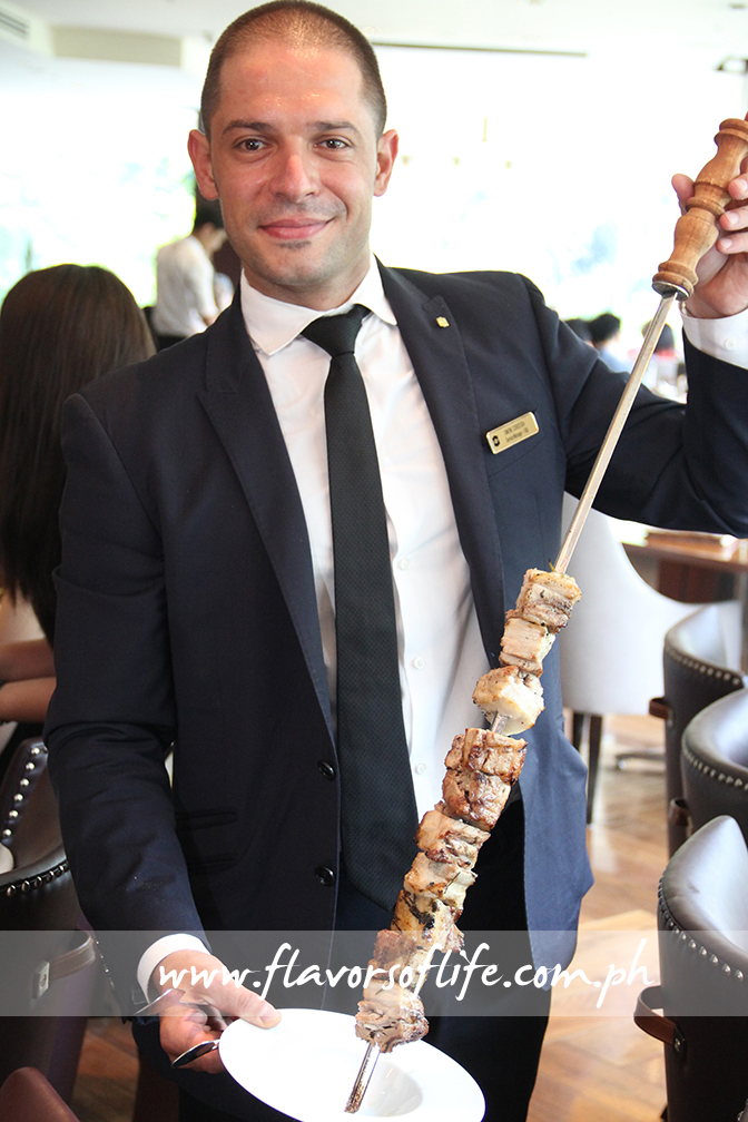 No less than service manager for F&B Simone Cordedda doing the honors of serving skewered barbecues