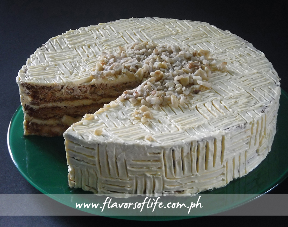 Classic Cipriano Sans Rival has makunat meringue layers, buttercream icing made from real butter, and loads of cashew nut