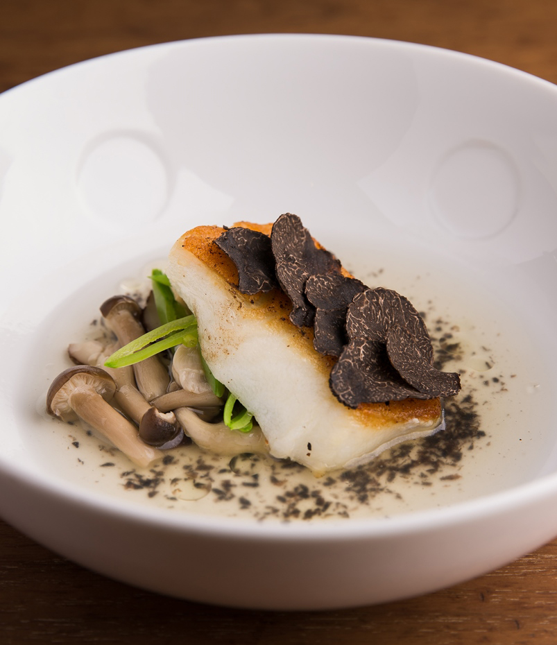 Pan-seared Sea Bass with Truffle Dashi Broth and Seasonal Mushrooms