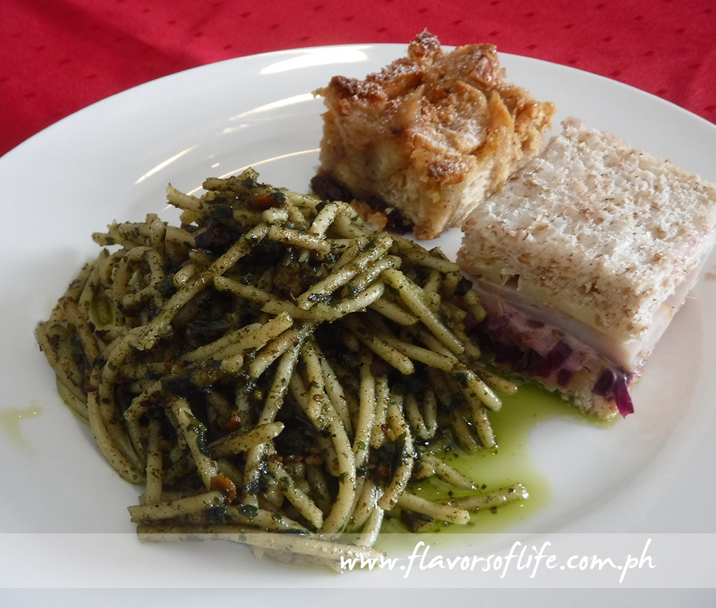 Platter of Herb Pistachio Pesto Pasta, Bread Pudding with Dried Fruits and Nuts, and Turkey Sandwich with Cranberry Slaw
