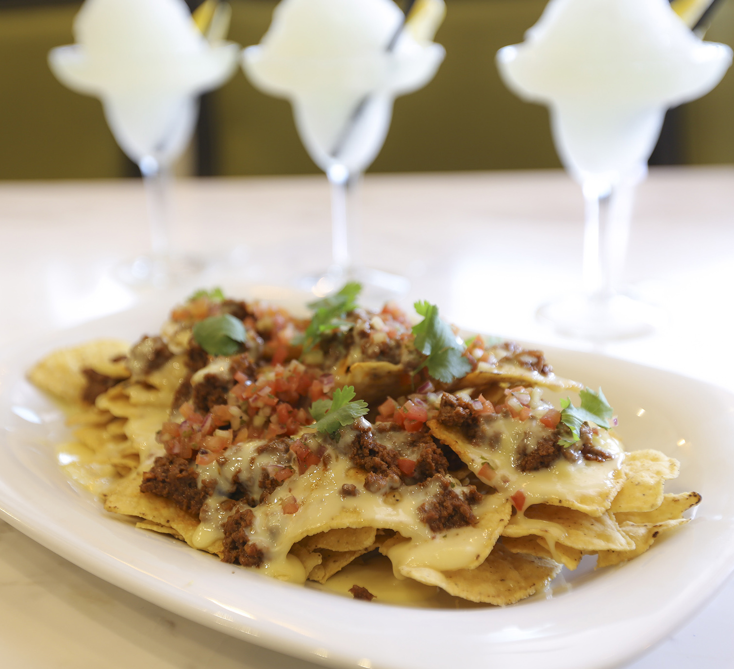 Cheesy Beef Nachos + three glasses of Frozen Margarita