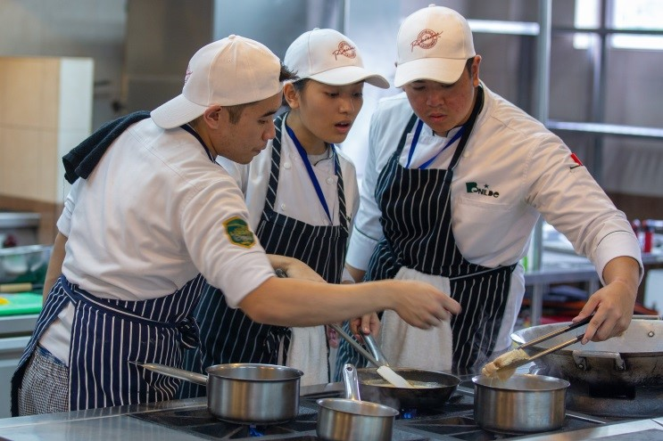 The De La Salle-College of Saint Benilde team preparing an appetizer using U.S. Turkey